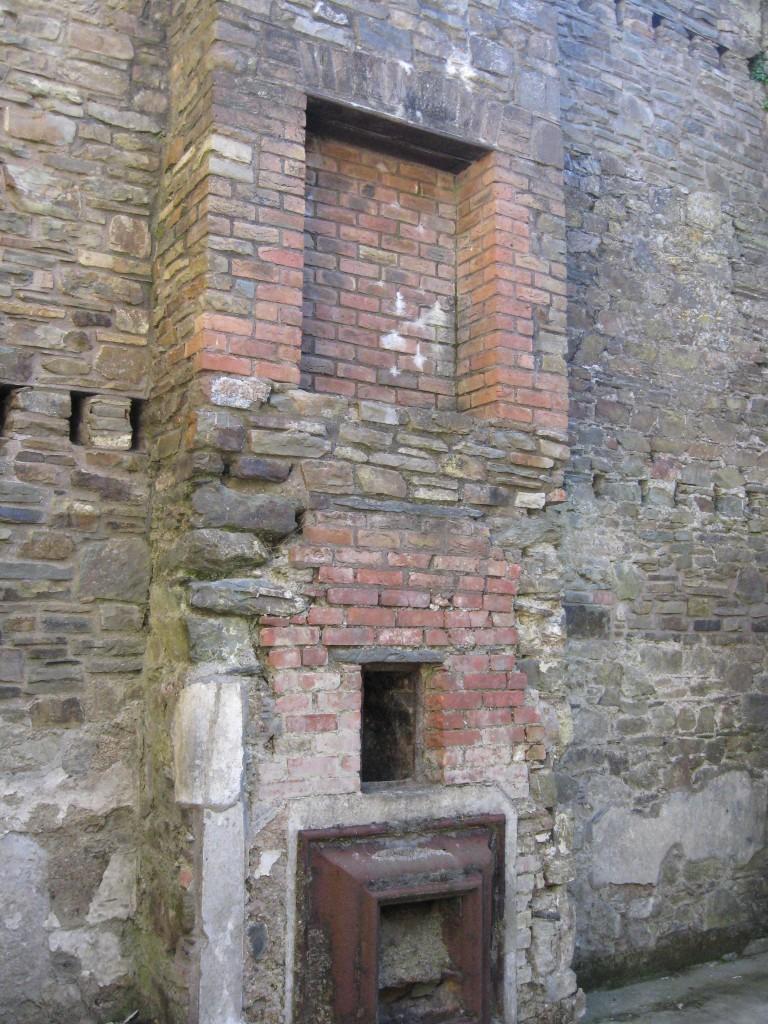 Fireplace/stove inside Barracks building, interior of Charlesfort